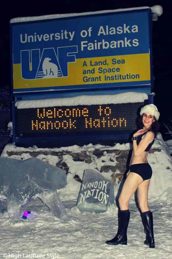 #nanook 50+ woman posing in front of a polar bear ice sculpture