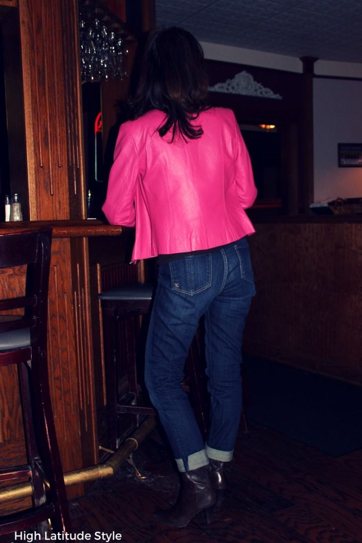 style blogger wearing denim pants and a pink tailored jacket with brown footwear