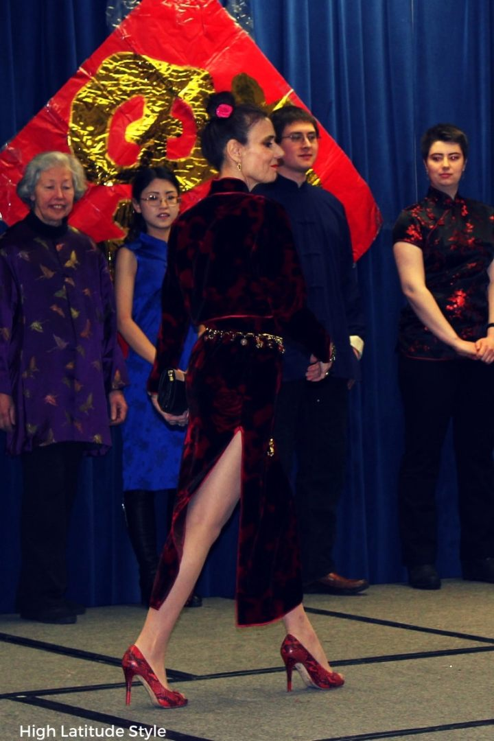 model on the catwalk showing off the long slit of a cheongsam