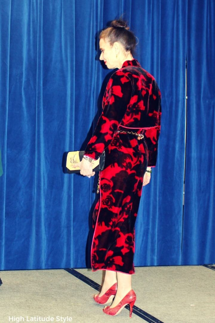 fashionista in a dress suit with clutch, pumps and charm belt at a New Year party