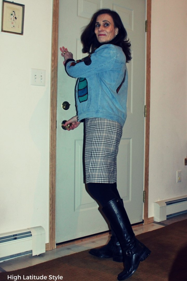 #fashionover50 style blogger in patched oversize denim jacket with houndstooth skirt and black tall boots
