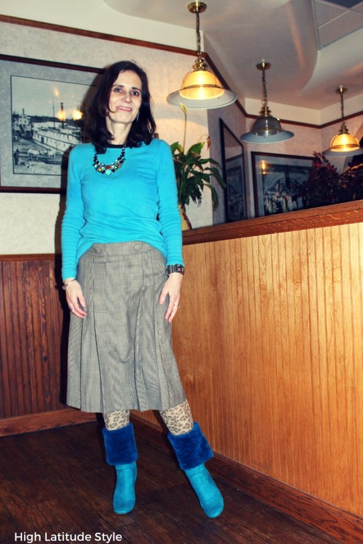 #fashionover50 style blogger Nicole in the mixed print trend with leopard stockings and glencheck skirt