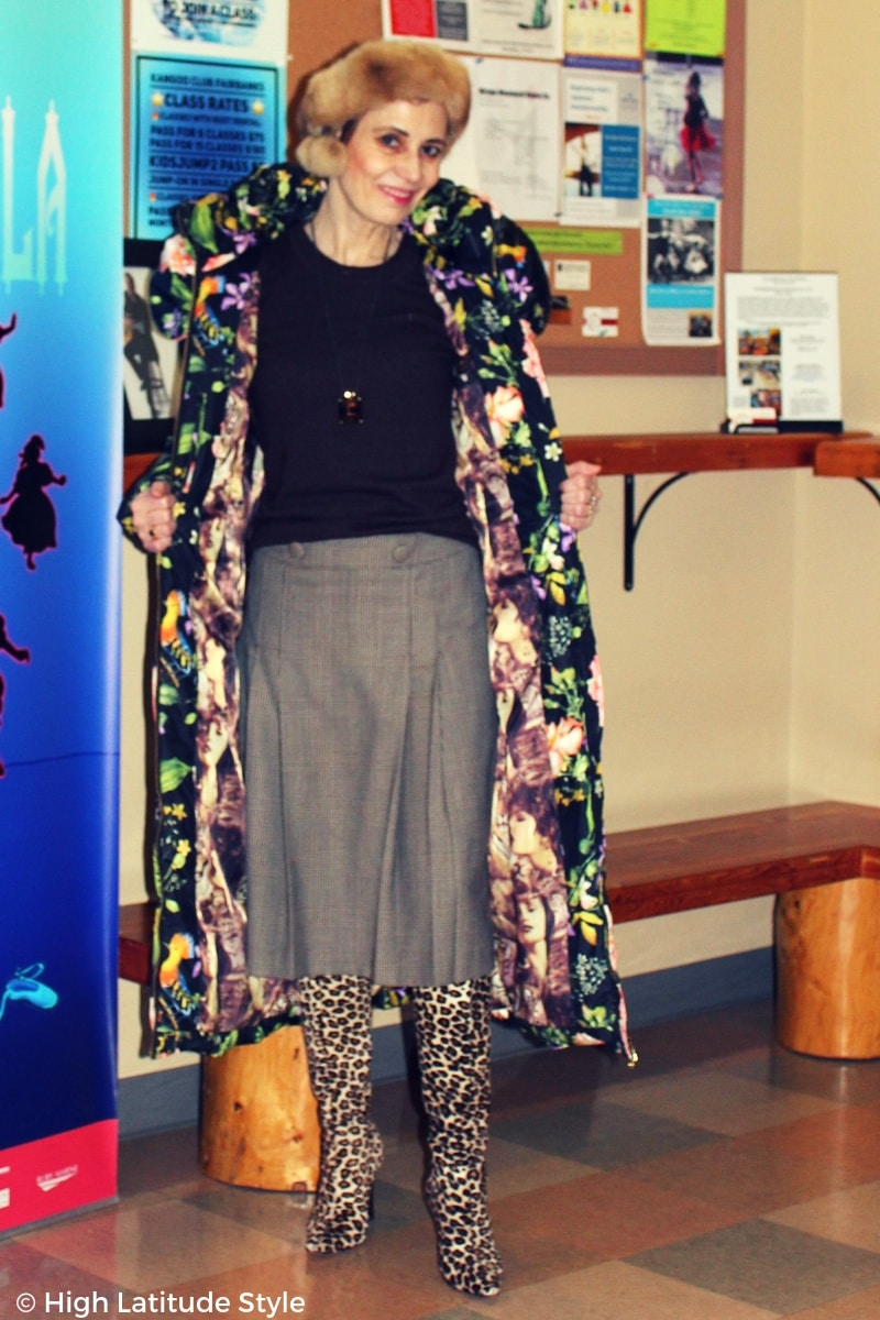 #winterstyle fashion blogger in floral puffer coat with contrasting lining winter outerwear over glencheck skirt, solid color sweater with leopard print footwear