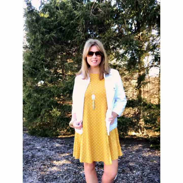 Michele Clark in a summery white and yellow look with polka dots