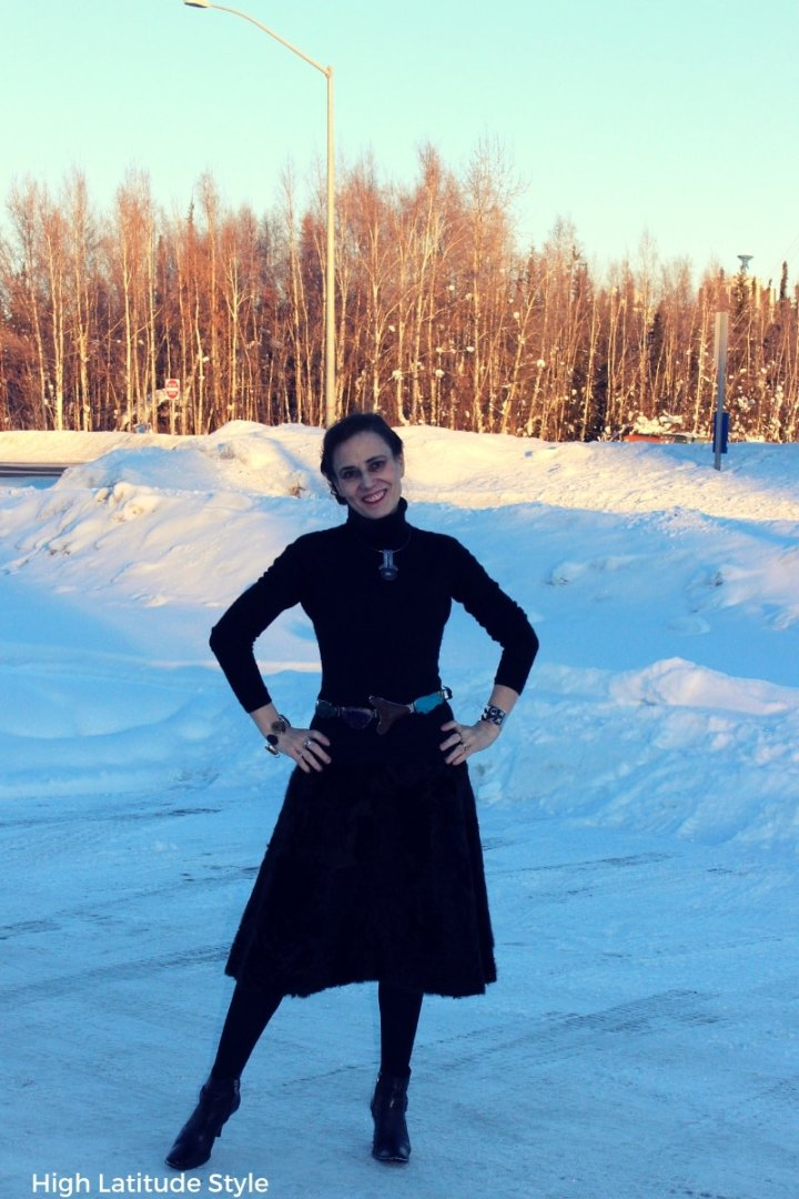 Nicole of High Latitude Style in fur a-line skirt, turtleneck sweater in all black