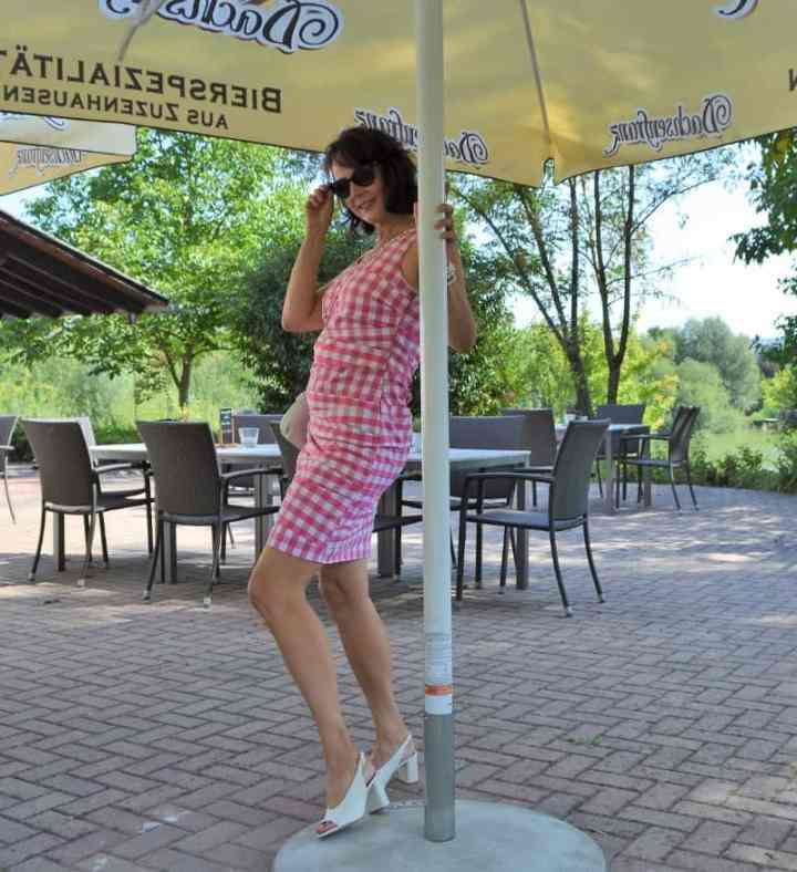 Birgit of Forty Fifty Happy in a gingham sheath dress