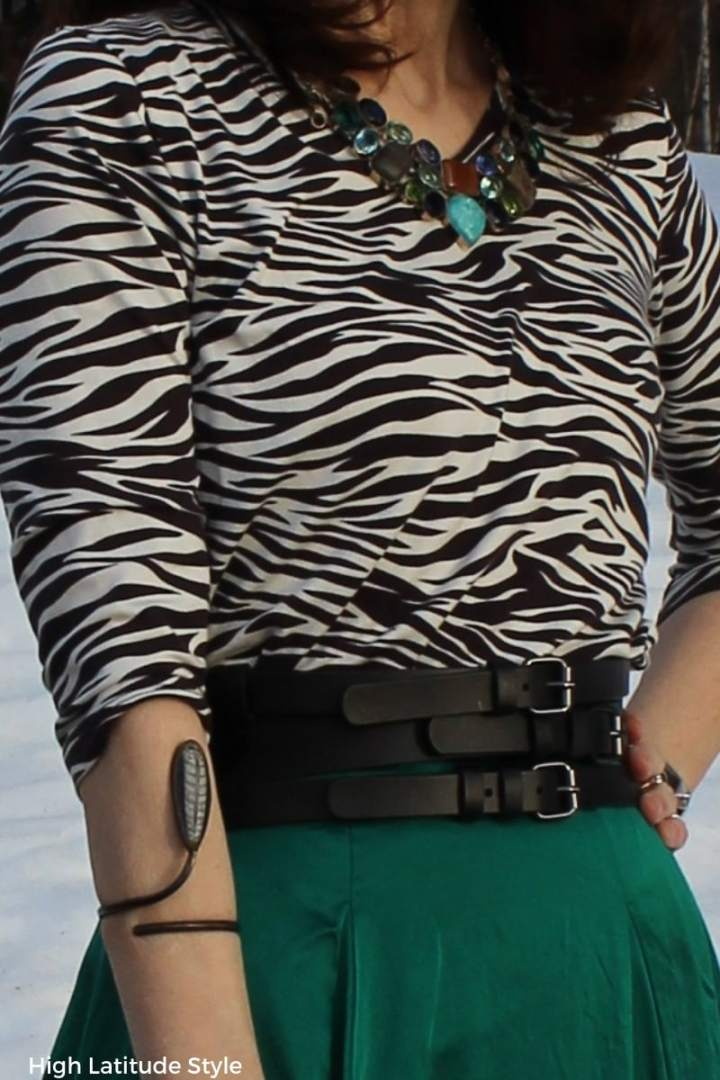 outfit details of belt, bangle and necklace