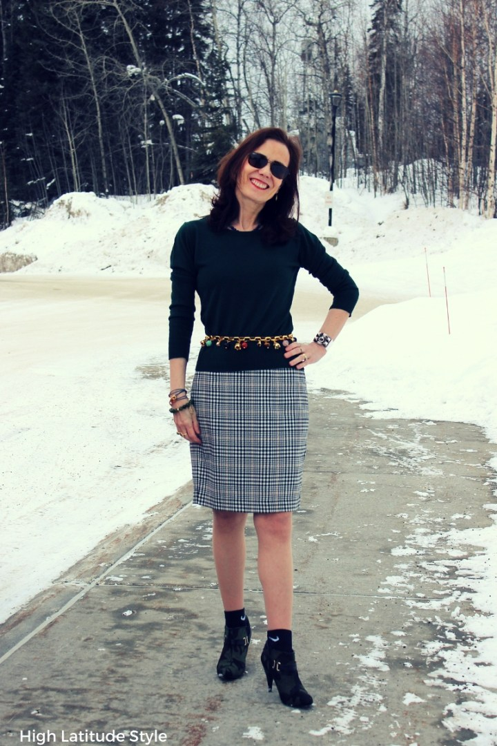 over 50 years old fashion blogger presenting an office look in Alaska in March