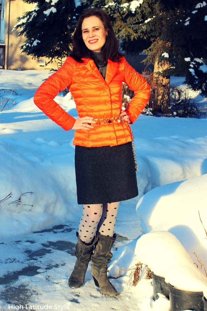 over 50 years old Alaskan style blogger in tweed skirt with down blazer and polka dot tights