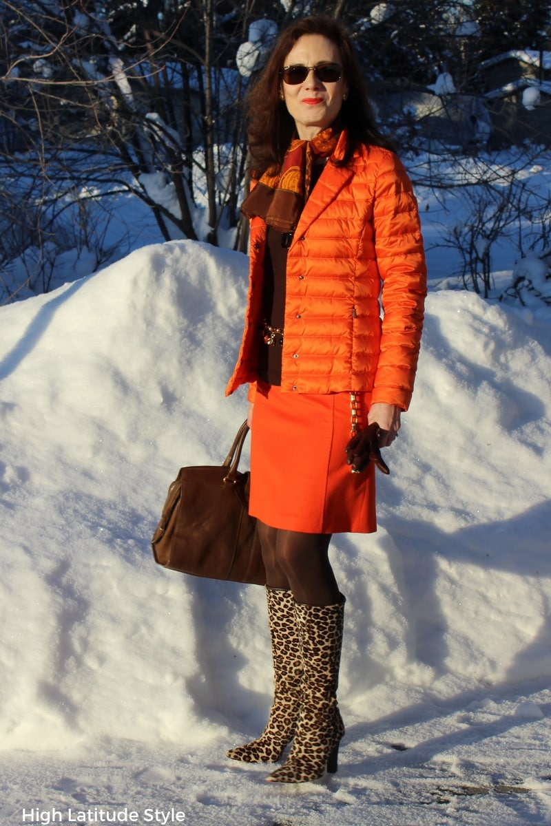 style blogger Nicole in casual business brown orange work outfit with wool skirt and puffer jacket