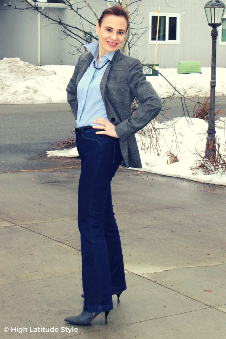 thrifting blogger in Casual Friday attire with blazer, button-down, necklace, jeans and booties