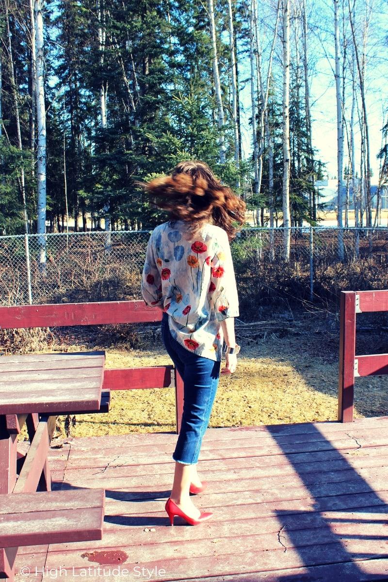 Alaskan blogger in spring OOTD posing in an urban forest