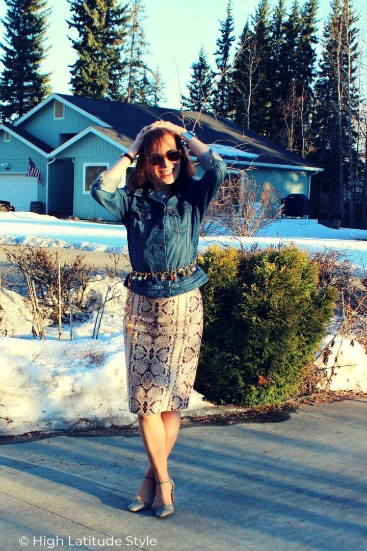 blogger over 50 in business casual Friday work look with jean and animal print