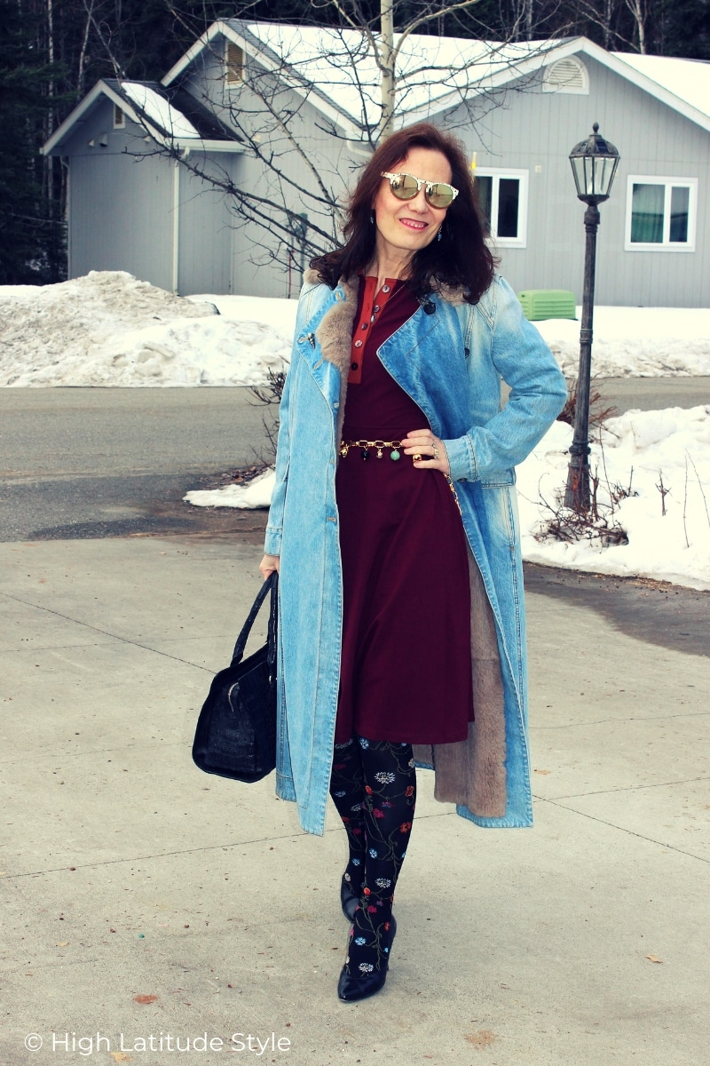 Nicole in denim coat, patterned tights, wooden sunglasses business travel look