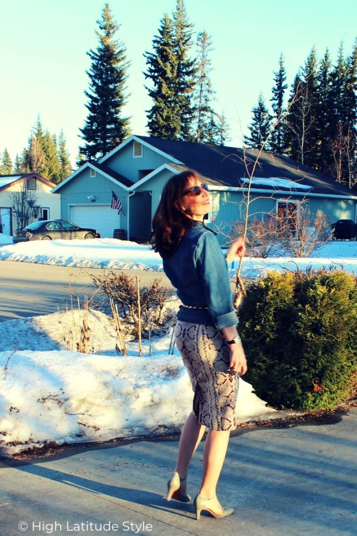 Nicole of High Latitude Style in a casual posh spring outfit with animal print skirt and jeans top
