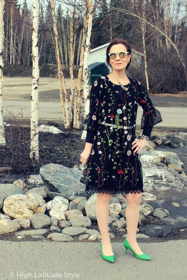 over 50 years old woman in black dress with floral embroidery