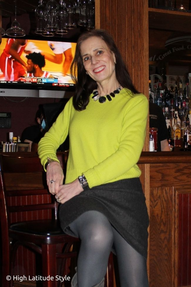 style book author in straight tweed skirt, cashmere sweater