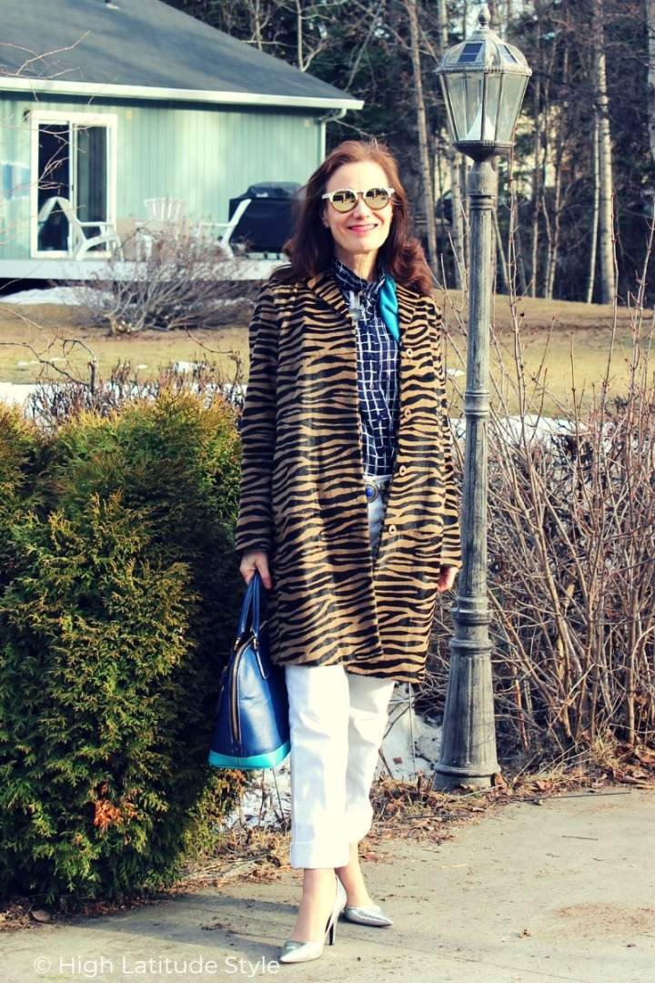 streetstyle look with animal print coat, window panel button-down, white denim pants and mirrored sunnies