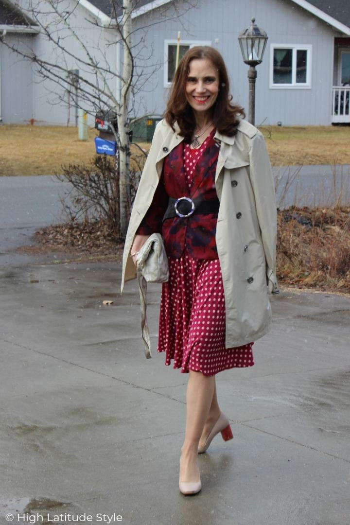 midlife blogger in business casual office outfit with blazer, dress, trench coat