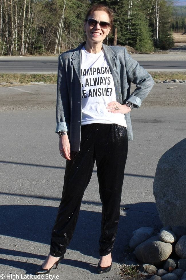 stylist in glam trousers, linen jacket, graphic Tee