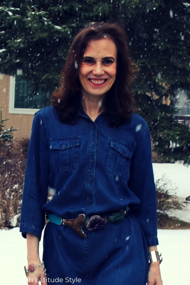 mature woman in denim with gemstone belt