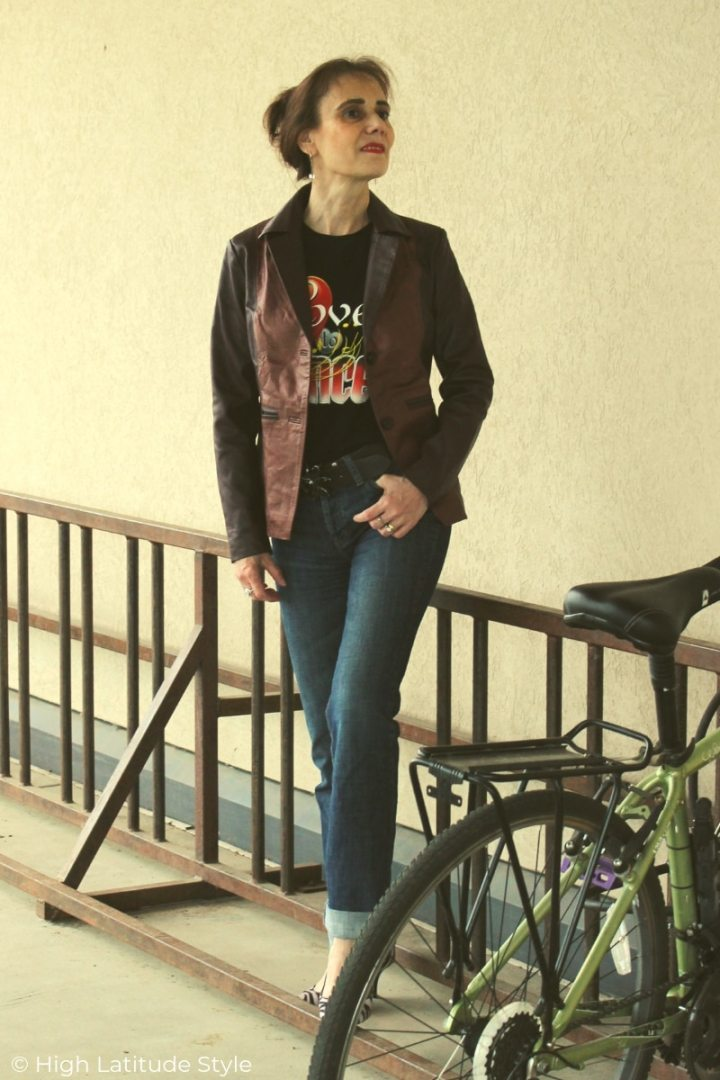 mature woman in leather jacket, jeans, heels and graphic Tee