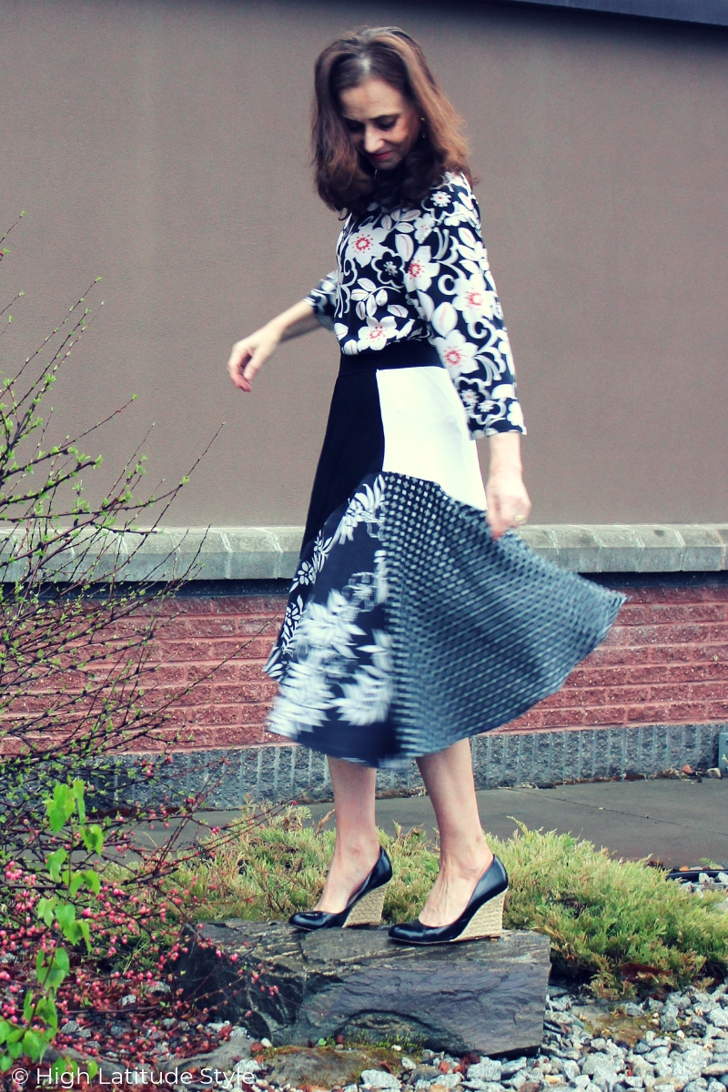 style blogger dancing on a rock in mixed print black and white date night look