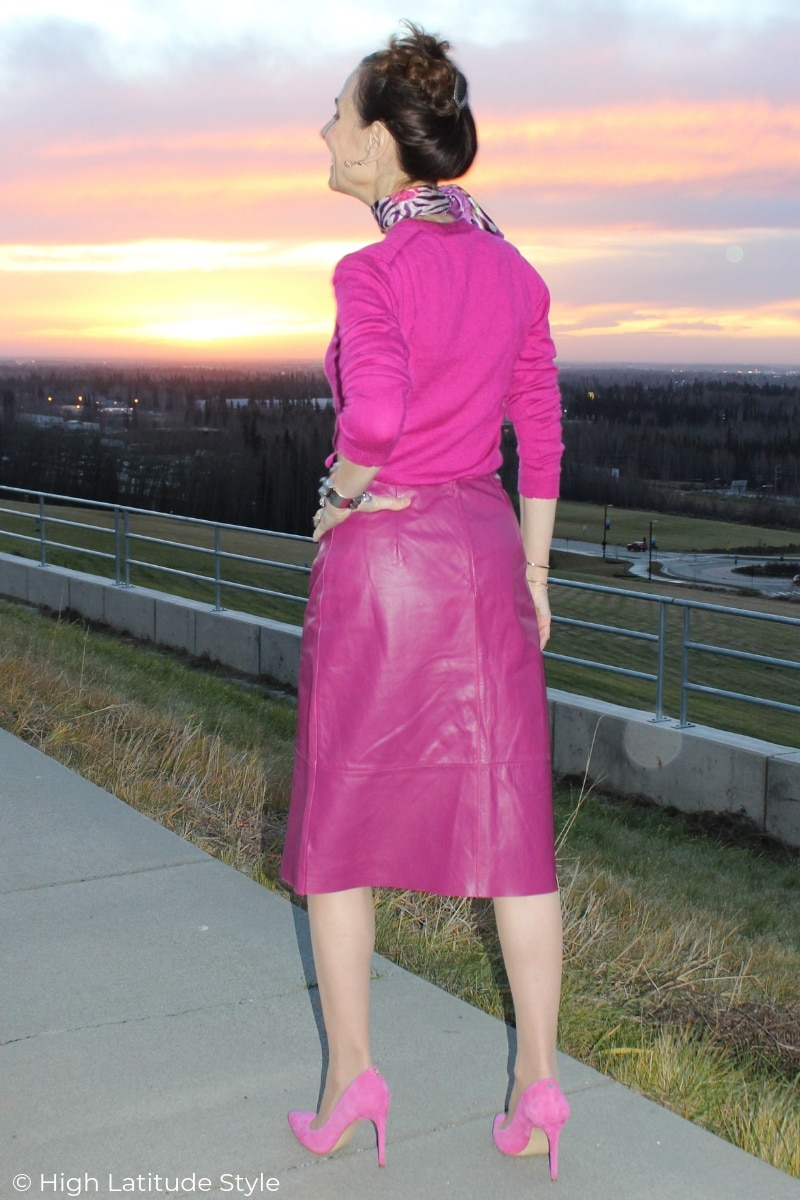 over 50 years old woman in a leather skirt and high heels standing at a view point in Alaska