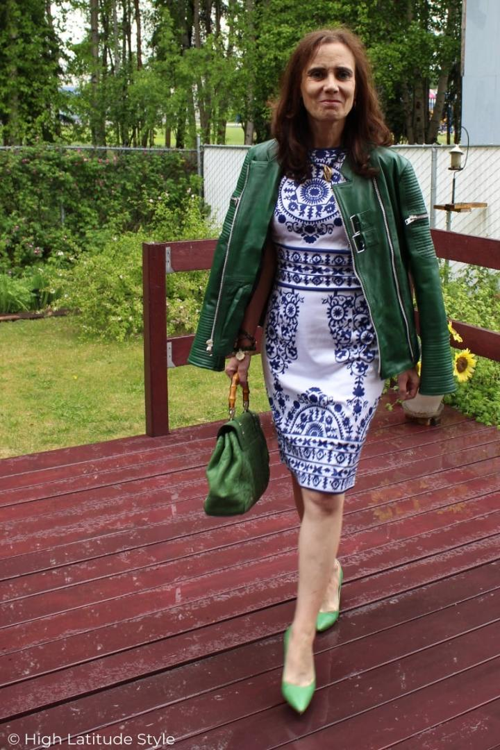 style blogger in summer dress with motorcycle jacket and pumps in the rain