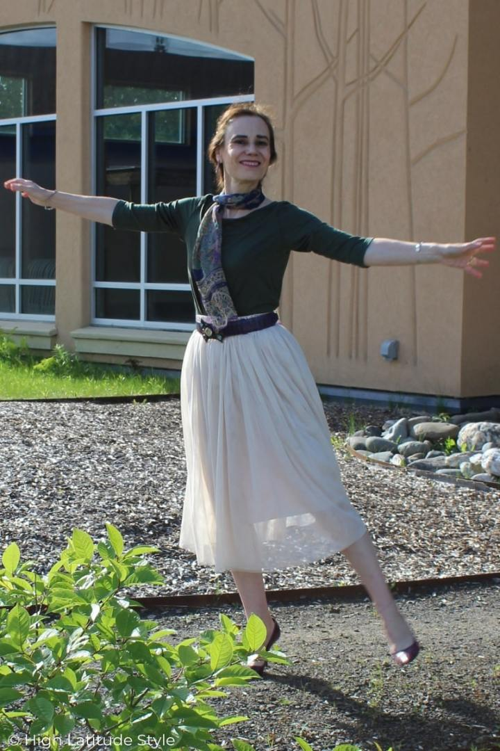 Nicole of High Latitude Style dancing in the park in a blush meshskirt and 3/4 sleeve Tee