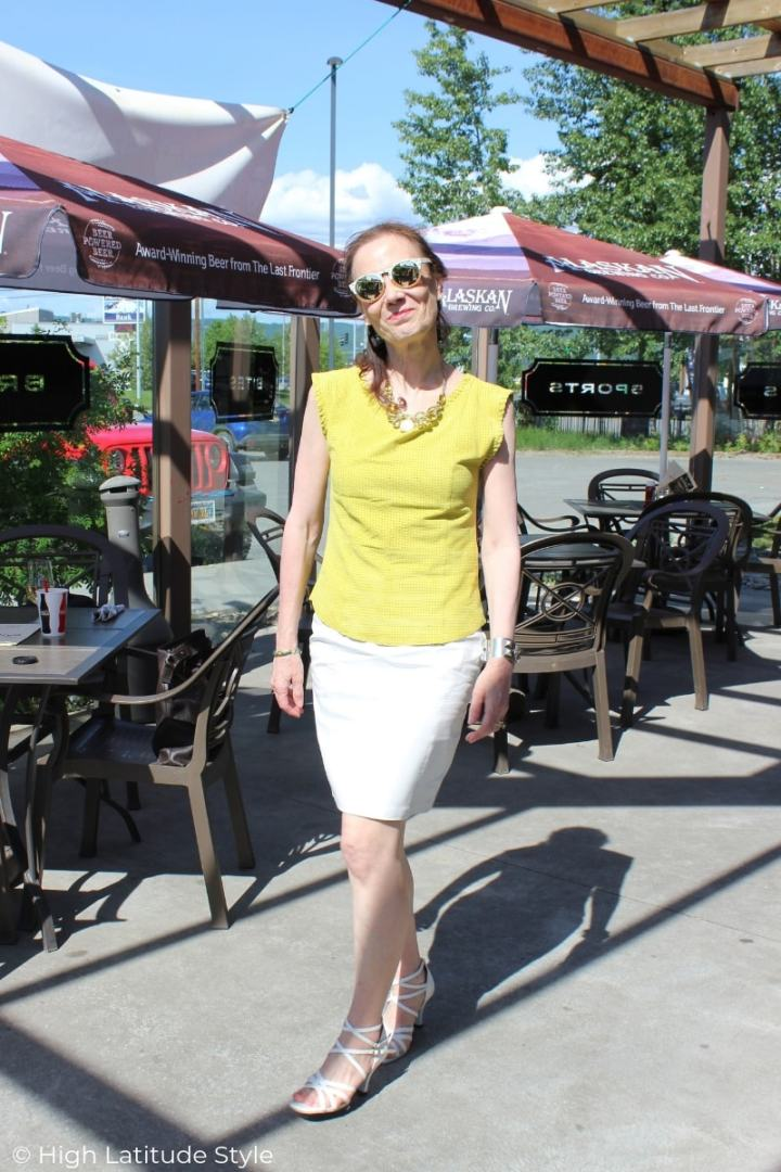 American woman in leather-on-leather summer outfit with yellow and white