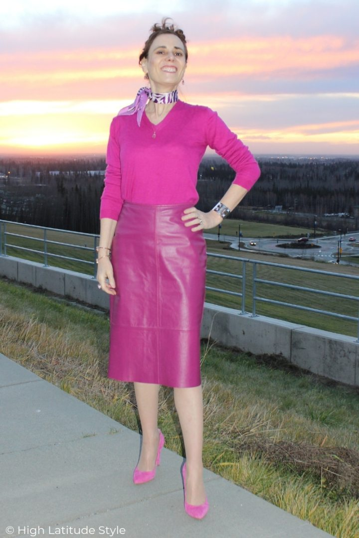 mature style blogger doning a monochromatic work outfit with leather skirt