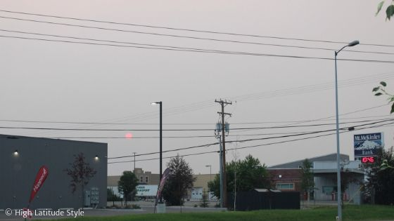 smoke from wildfires dime the light of the Sun so badly that the street lights are on