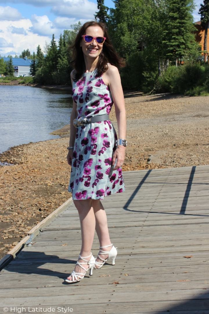 over 50 years old fashion blogger in white sandals and pruprle print designer garment