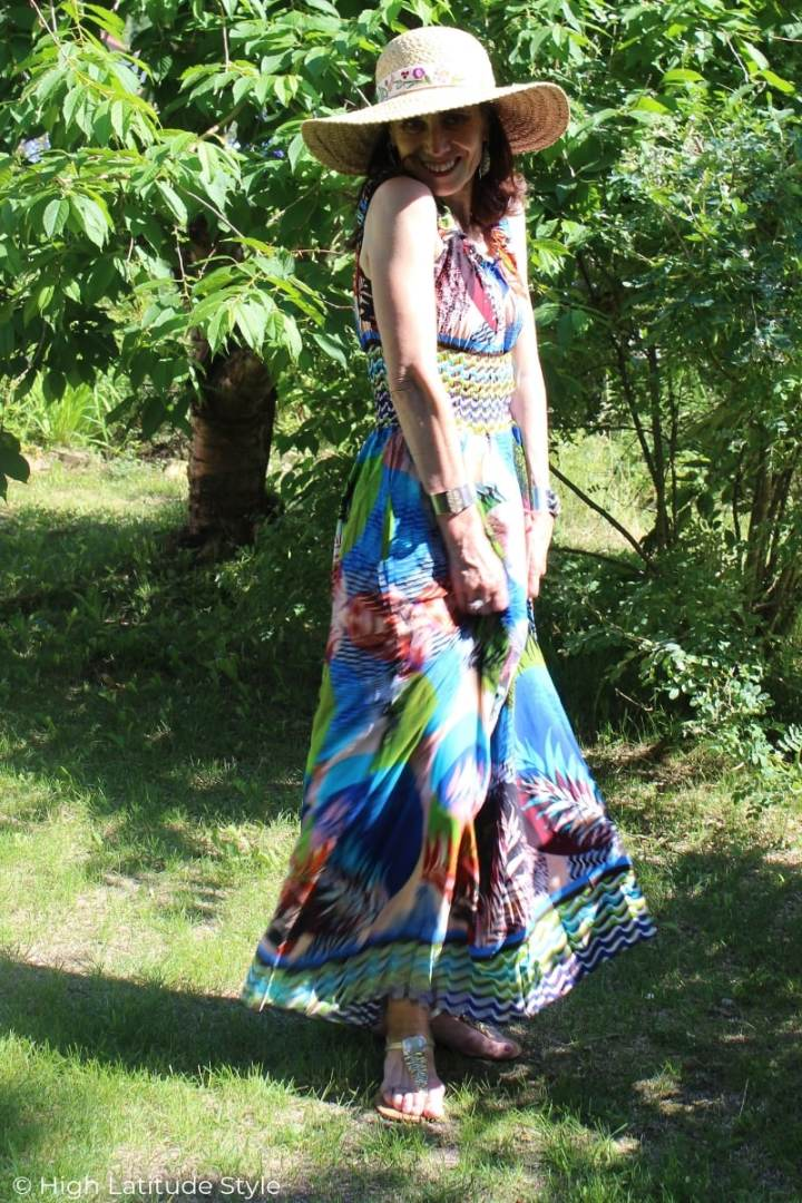 Nicole of High Latitude Style featuring a Bohemian inspired maxi summer dress with hat and sandals