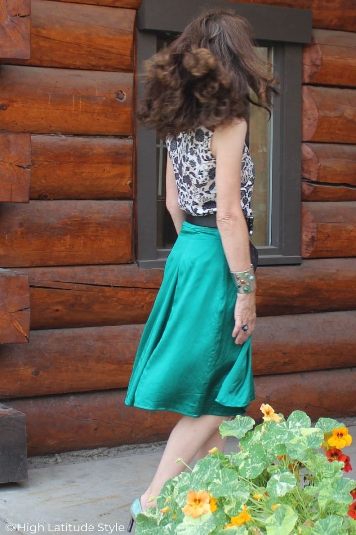 midlife woman in green skirt, printed top Sunday brunch look
