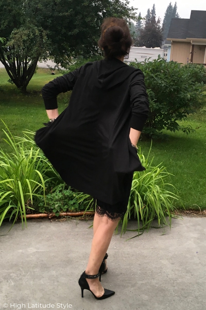 back view of work look with long hoodie cape and lace skirt