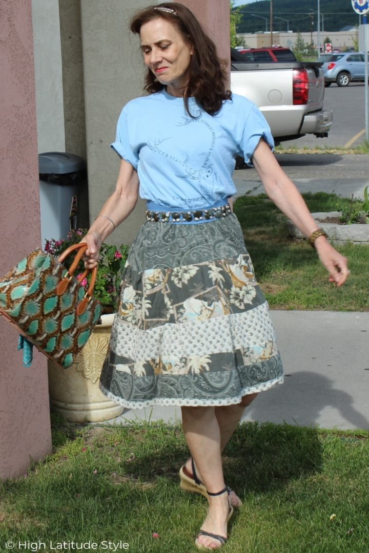 mature woman in self-sewn skirt styled with graphic T-shirt, statement belt