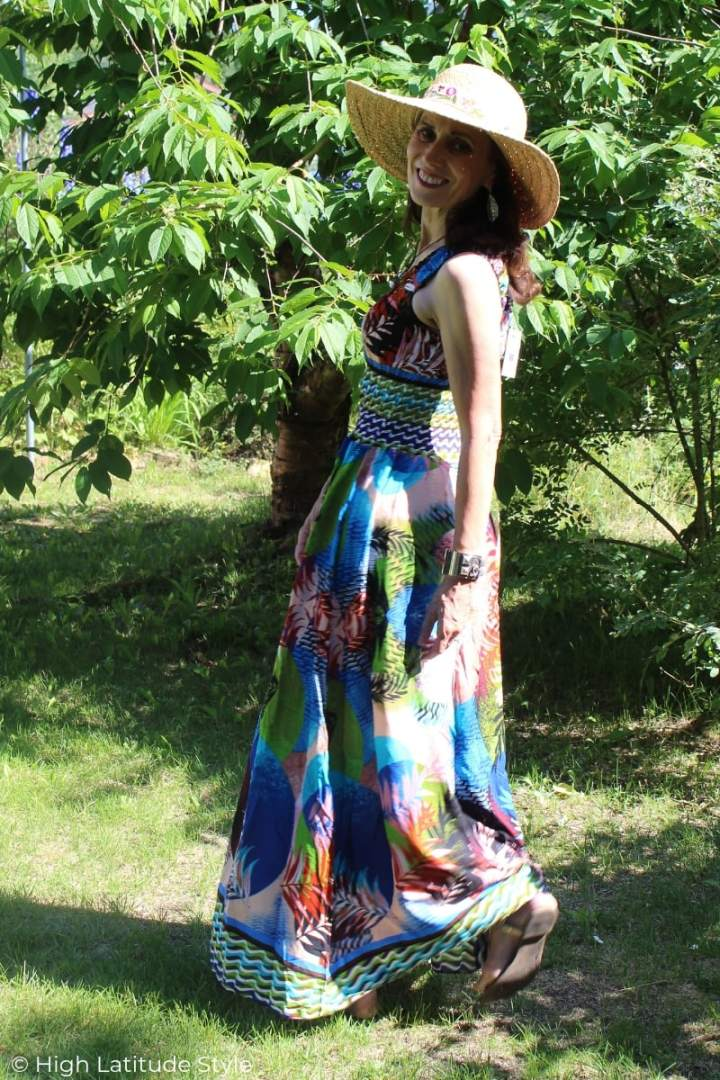 over 50 years old style book author in Fashom maxi dress walking in the yard