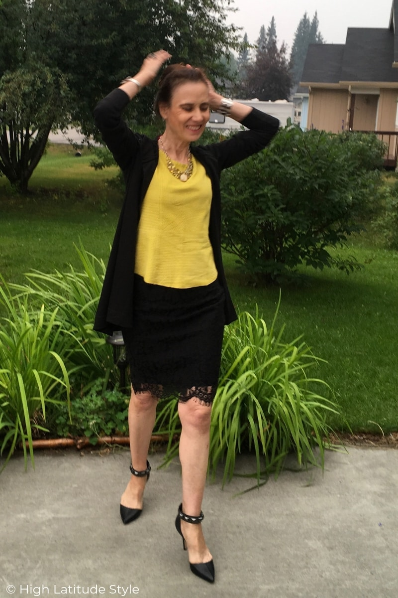 Nicole of High Latitude Style in fall office attire in black and yellow