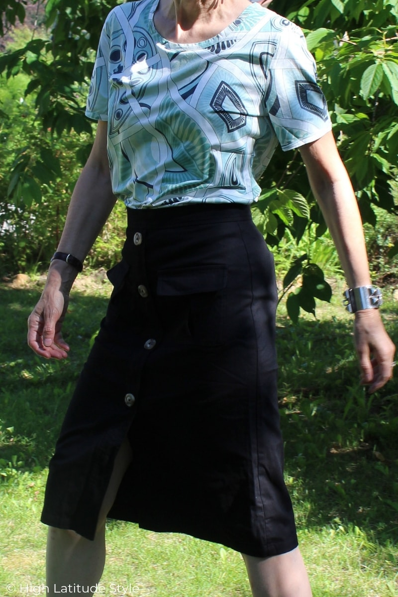 black A-line skirt with button front and interesting print blouse