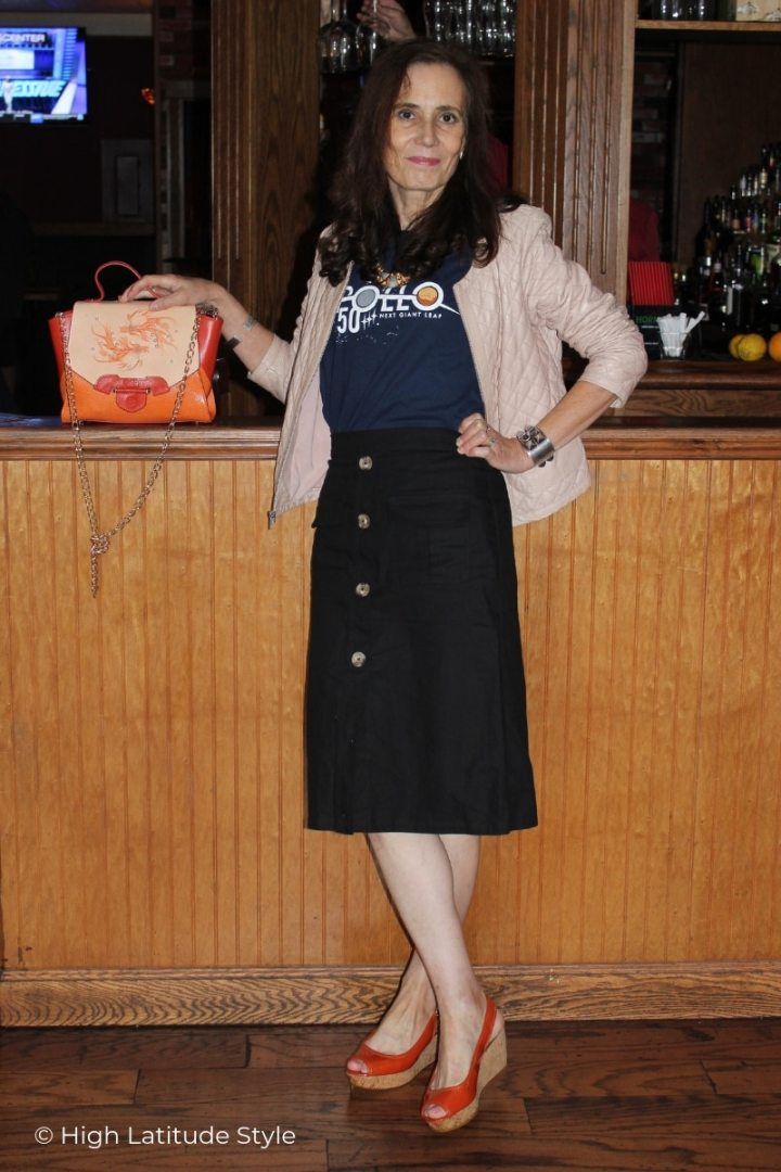 mature Alaskan in orange, black, blue and blus casual look with skirt, Tee, jacket, sandals