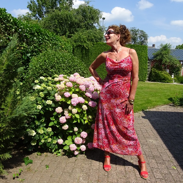Nancy Baten of Nancy's Fashion Style in maxi dress