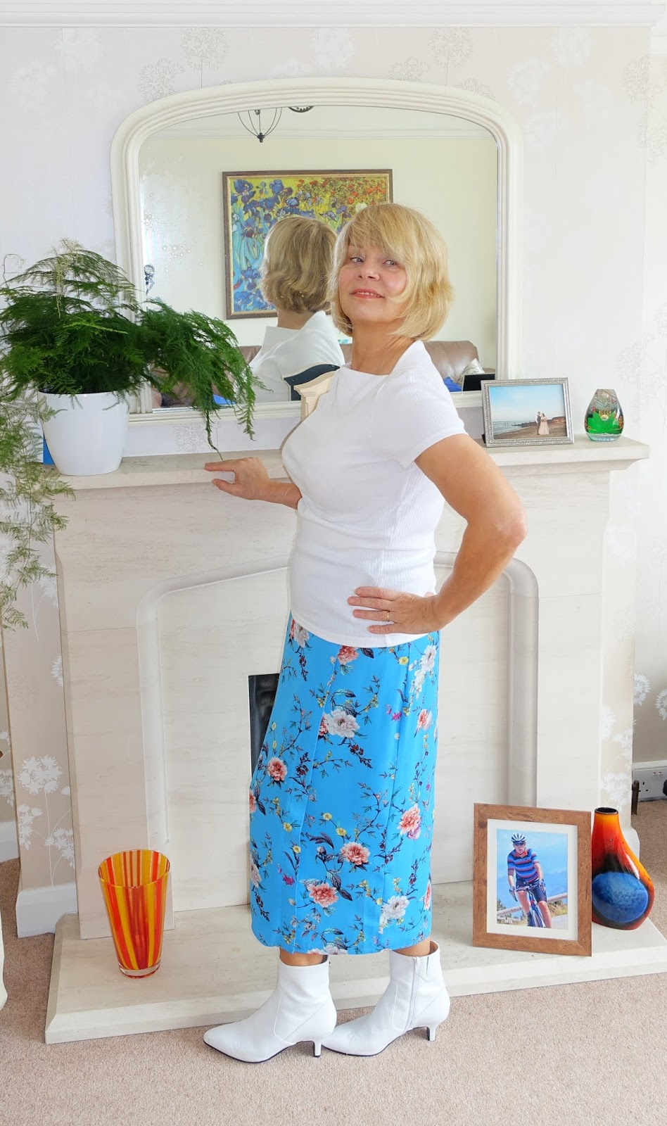 Top of the World Style Winner in white booties, turquoise floral skirt, white tee
