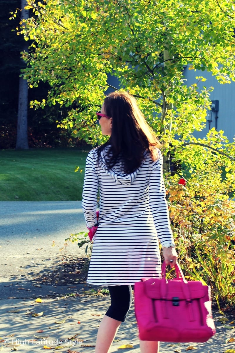 Alaskan blogger walking down the street in striped hoodie with cropped leggings