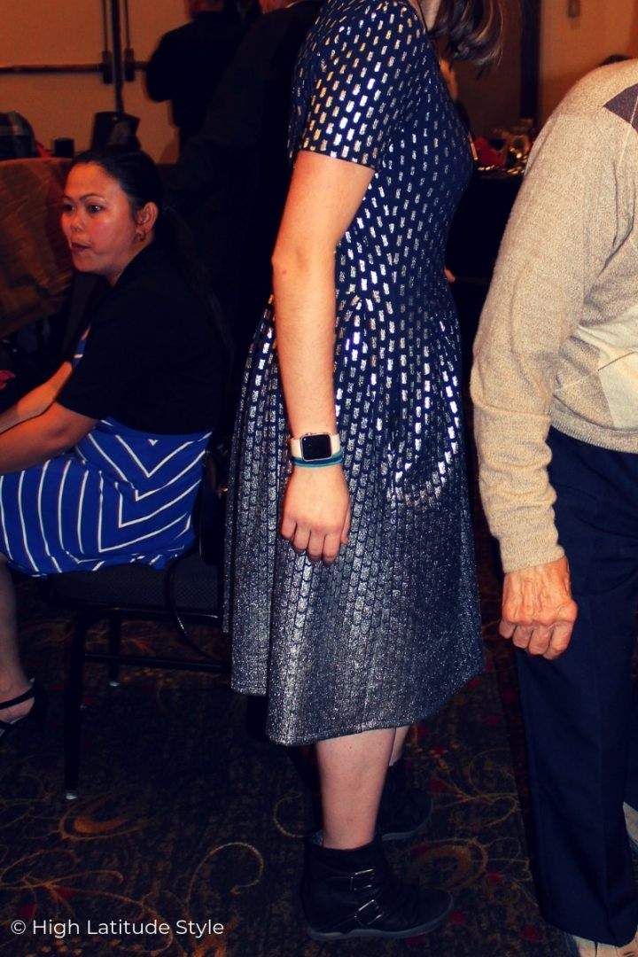 silver and navy brocade midi dress with shearling booties and fitness gadget
