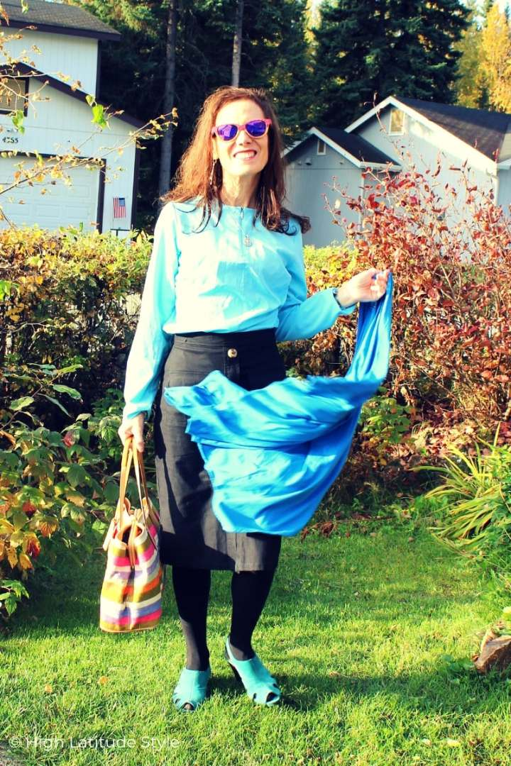 style book author in blue black fall style with shirt, long cardigan and collarless shirt