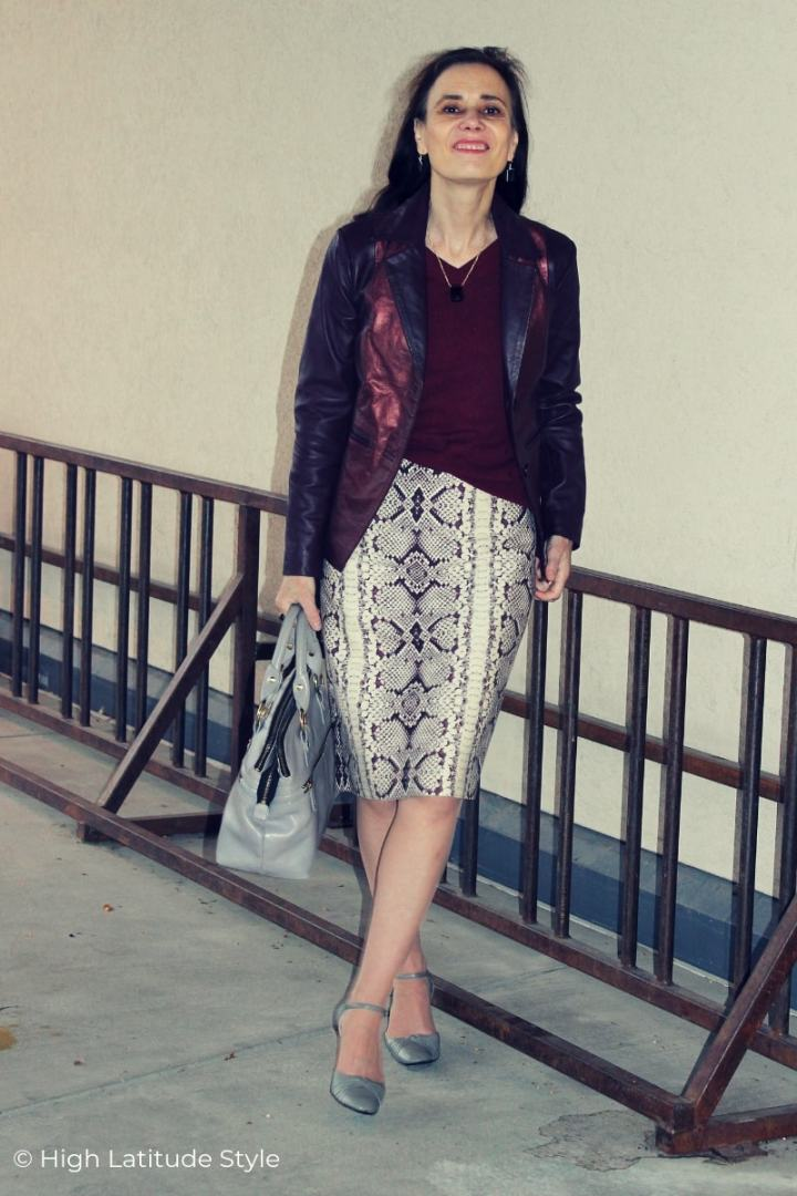 Nicole in staright burgundy gray skirt with gray shoes and burgundy top and jacket
