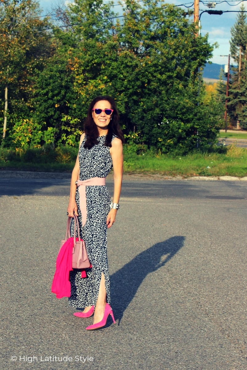 mature woman in tank trousers ensemble showing off the leg slit