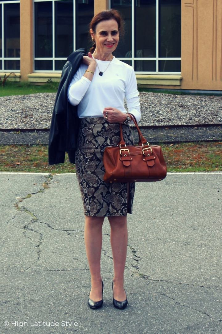 fashion blogger over 50 looking posh in trendy snake print pencil skirt and white top